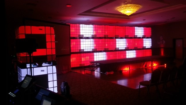 IBC Lighting backdrop with IBC containers lit up red and white for another conference.