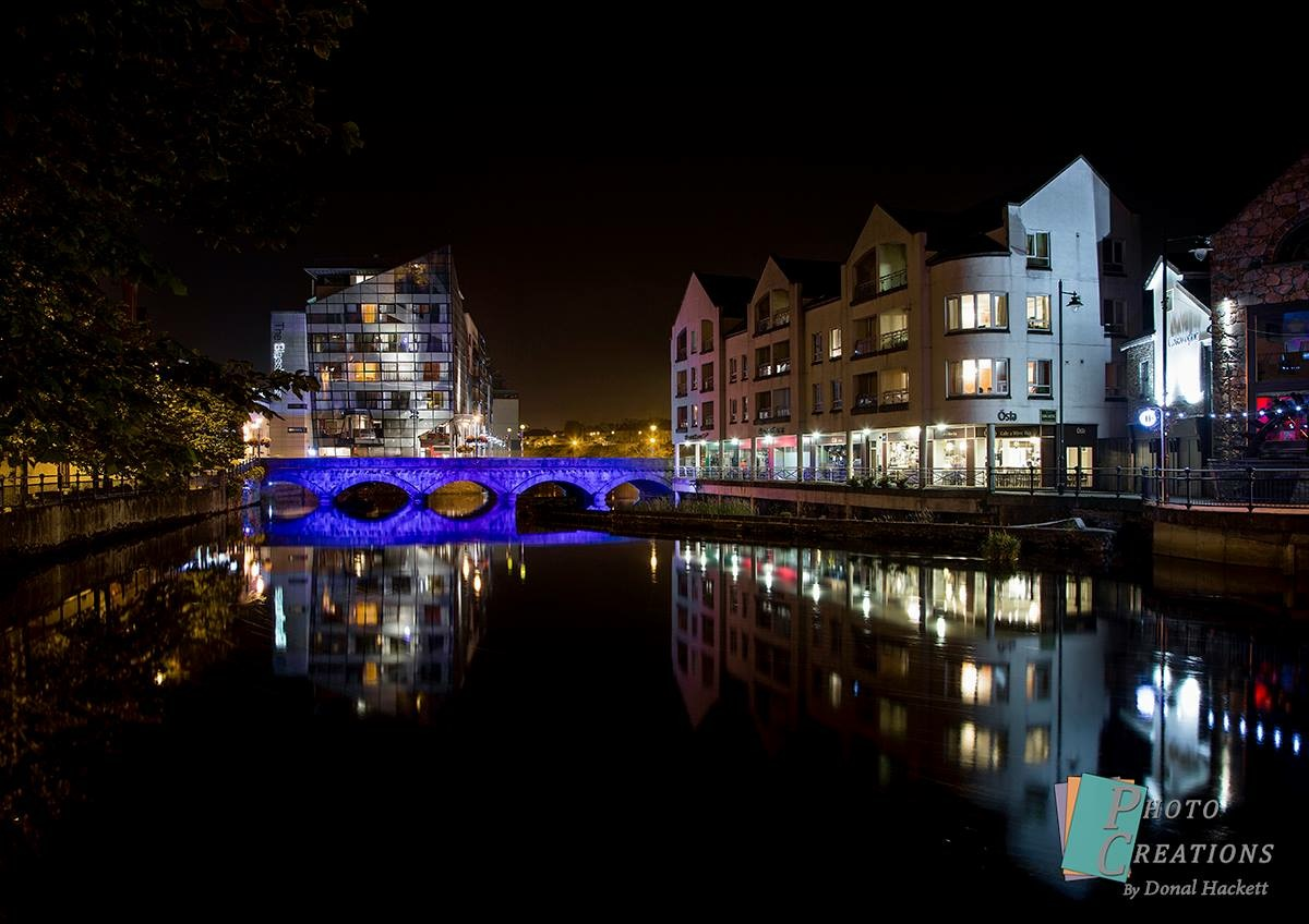 Main bridge in Sligo lit up blue with the Glasshouse in the background