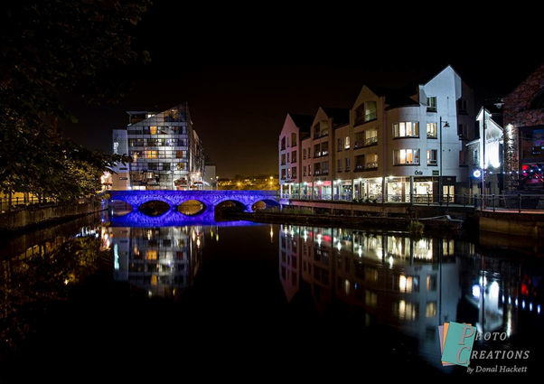 The lighting of the bridges on Garavogue River in Sligo Town.